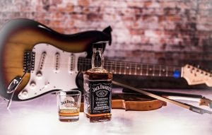 Guitar and whiskey.