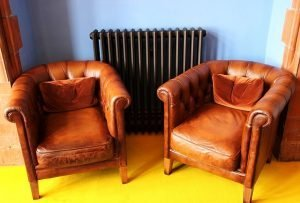Leather arm chairs waiting to packed