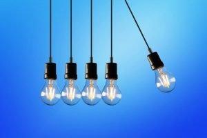 Five light bulbs on a blue background