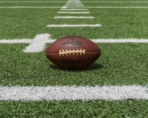 Leather football on a grass field