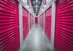a row of red colored storage units