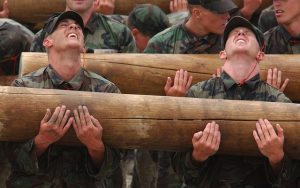 Strong soldiers carrying heavy lumber