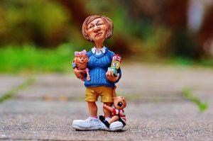 Nanny figurine holding two babies