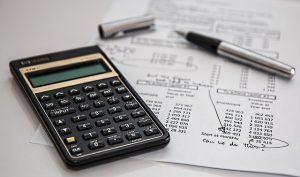 Calculator paper and a pen