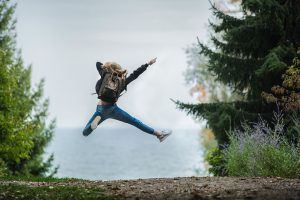 girl jumping happily