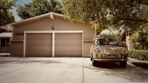 car in front of a garage