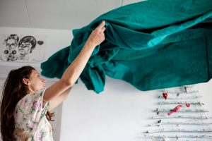 woman cleaning with the help of a Room by room spring cleaning checklist