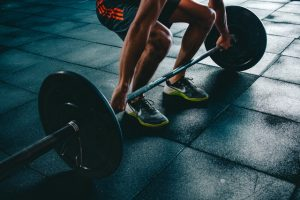 man dead-lifting weights for moving day workout