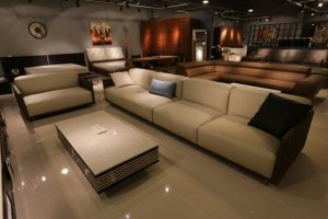 Big sofa, an armchair and a huge coffee table for decorating a new home