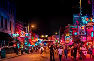 Photo of Beale Street in Memphis at night, filled with people and vivid, neon colors everywhere