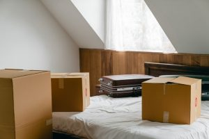 cardboard boxes on a bed