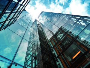 A tall glass building perfect for starting a business in Cordova