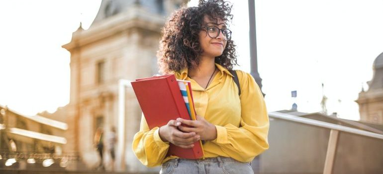 A girl holding books