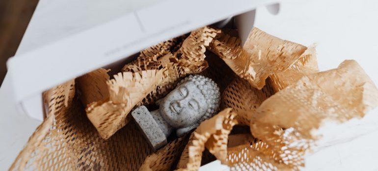 Packing a granite Buddha