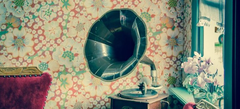 A gramophone on an antique table, representing items that furniture movers Memphis TN help relocate.