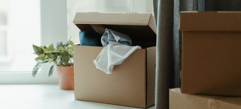 clothes in a moving box