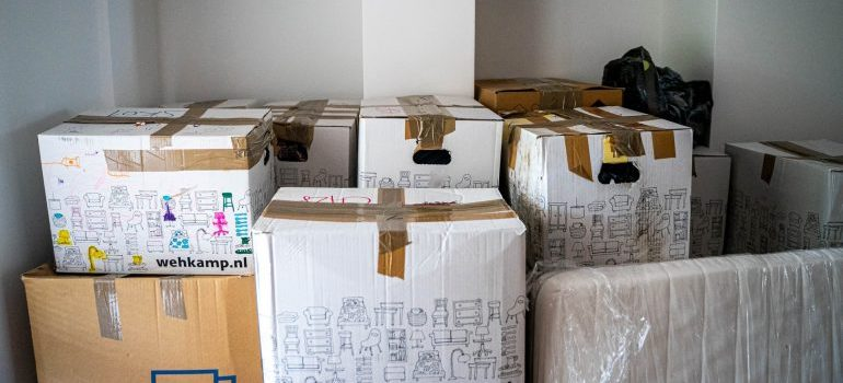 a pile of boxes to measure in order to determine the size of storage you need