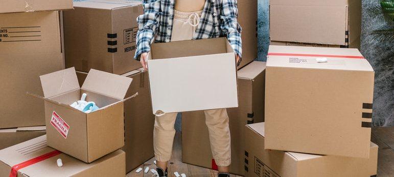 A woman holding a carton box